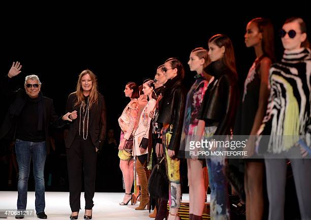 Italian designer Roberto Cavalli and his wife Eva acknowledge the crowd after their fashion show as part of the Milan's Women's fashion week...