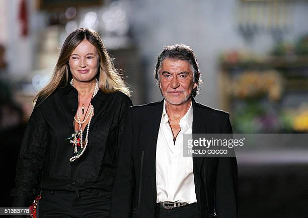 Italian designer Roberto cavalli and his wife Eva walk on the catwalk at the end of his Spring/Summer 2005 women collection presentation during Milan...
