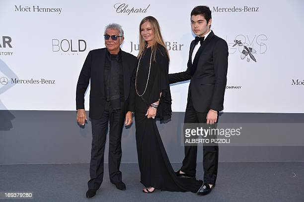 Italian designer Roberto Cavalli his wife Eva and their son Robin pose on May 23 2013 as they arrive to attend the amfAR's 20th Annual Cinema Against...