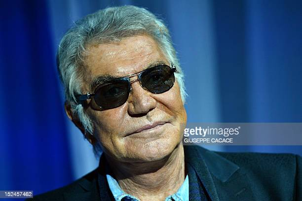 Italian designer Roberto Cavalli poses prior the Just Cavalli Spring-Summer 2013 collection on September 21, 2012 during the Women's fashion week in...