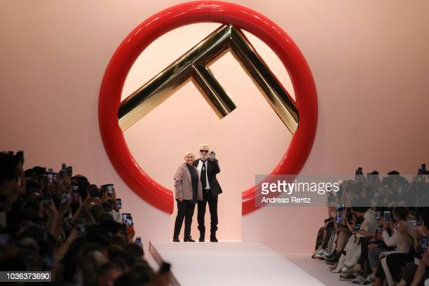 Italian designer Silvia Venturini Fendi and German fashion designer Karl Lagerfeld acknowledge the applause of the audience at the Fendi show during...