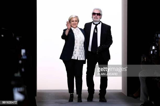 3431c9c0dab8 Italian designer Silvia Venturini Fendi and German fashion designer Karl  Lagerfeld acknowledge the audience at the