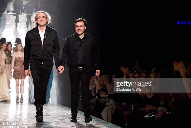 Italian designers Antonio Grimaldi and Sylvio Giardina walk the runway during the Grimaldi Giardina Haute Couture Spring/Summer 2009 fashion show on...
