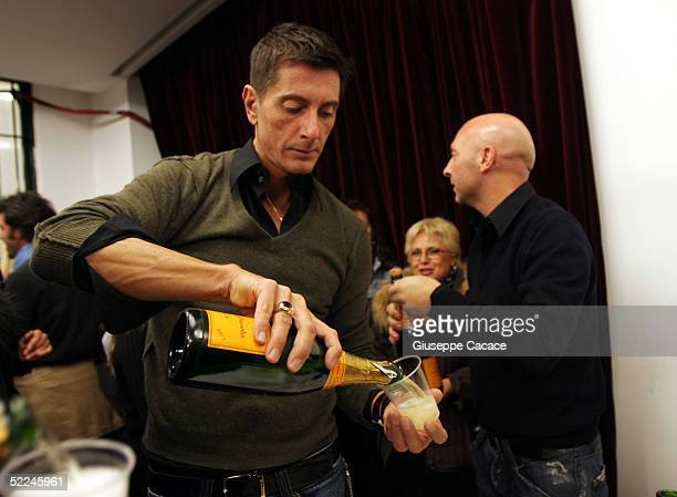 Italian designers Domenico Dolce and Stefano Gabbana celebrate at the end of the Dolce Gabbana fashion show as part of Milan Fashion Week...