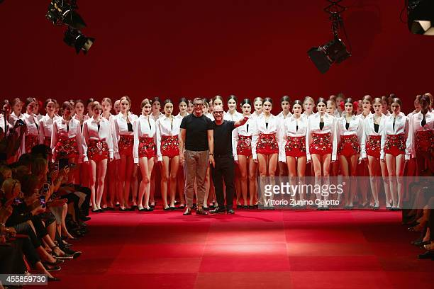 Italian designers Stefano Gabbana and Domenico Dolce acknowledge the applause of the audience after the Dolce & Gabbana show as a part of the Milan...