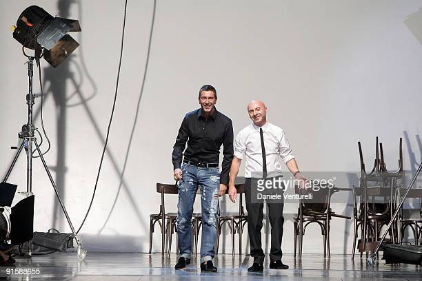 Italian designers Stefano Gabbana and Domenico Dolce acknowledge the applause of the public after the Dolce Gabbana show as part of Milan Womenswear...