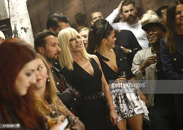 Italian desinger Donatella Versace and Versuss creative director Anthony Vaccarello take part in the launch party of Versace's diffusion label at the...