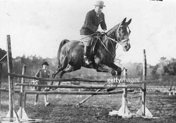 Italian dictator Benito Mussolini enjoying a ride on his horse in the grounds of his villa 'Borgnese' Original Publication People Disc HW0228