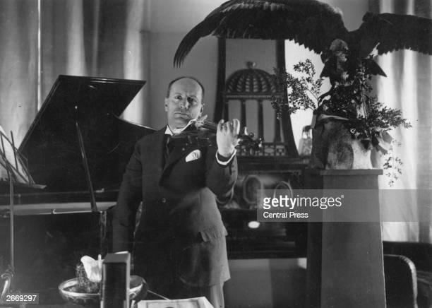 Italian dictator Benito Mussolini playing a violin