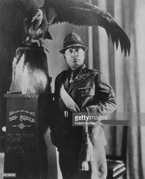 Italian dictator Benito Mussolini symbolically posing beneath an eagle