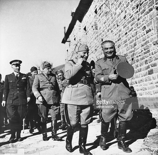 Italian dictator Benito Mussolini talking to Gastone Gambara General Officer Commanding VIII Corps During a visit to a rear operational area during...