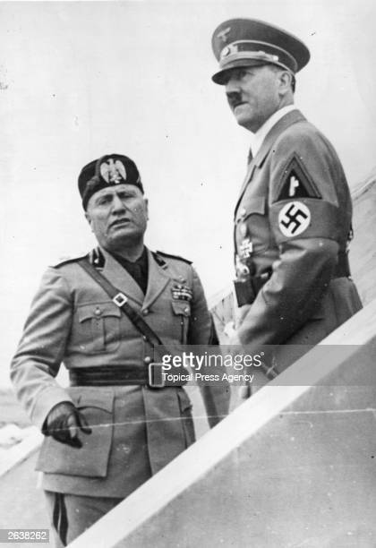 Italian dictator Benito Mussolini with German dictator Adolf Hitler watching a military display being held at the Camp of Cento Celli Original...