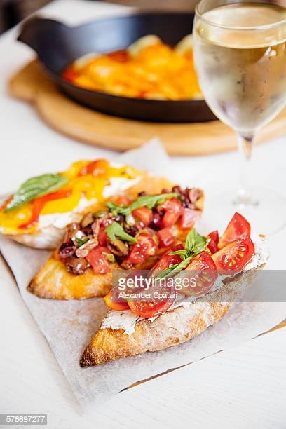 Italian dinner with bruschettas and white wine