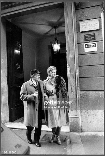 Italian director Alessandro Blasetti and Italian actress Carla Gravina walking in the street. Rome, 1974.