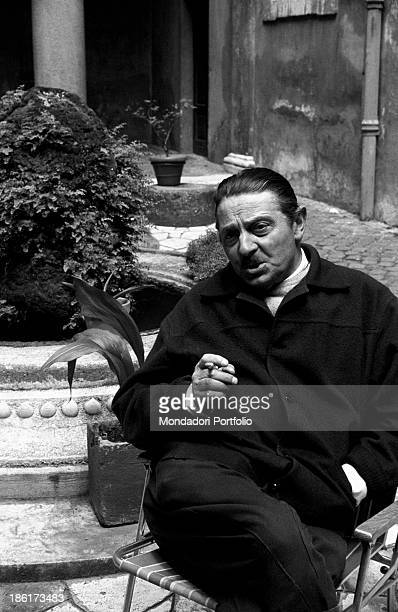 Italian director Alessandro Blasetti relaxing smoking a cigarette on the set of Me Me Me and the Others Rome June 1965