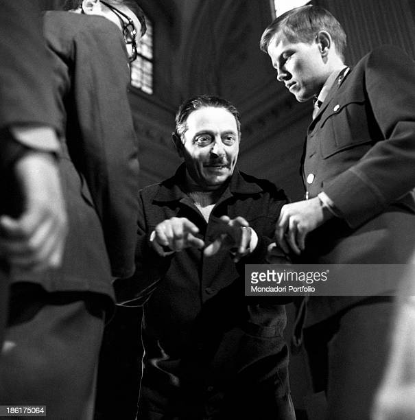 Italian director Alessandro Blasetti talking to the actors on the set of of Me Me Me and the Others Rome June 1965