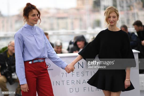 Italian director Alice Rohrwacher and her sister Italian actress Alba Rohrwacher pose on May 14 2018 during a photocall for the film Happy As Lazzaro...
