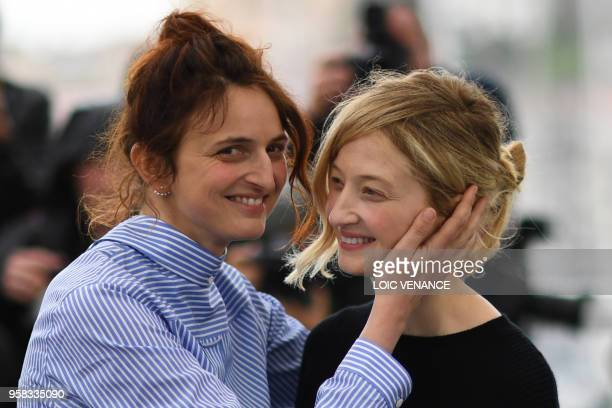 TOPSHOT Italian director Alice Rohrwacher and her sister Italian actress Alba Rohrwacher pose on May 14 2018 during a photocall for the film Happy As...