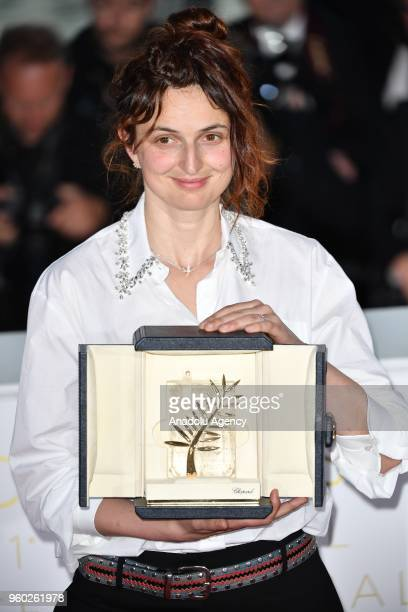 Italian director Alice Rohrwacher poses during the Award Winners photocall after she won Best Screenplay Prize for Lazzaro Felice at the 71st Cannes...