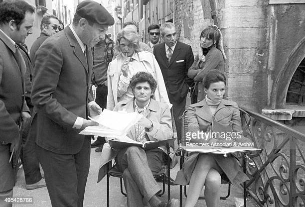 Italian director and actor Enrico Maria Salerno Brazilian actress Florinda Bolkan and American actor Tony Musante having a break on the set of the...