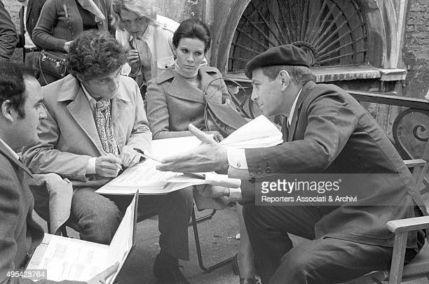 Italian director and actor Enrico Maria Salerno illustrating some scenes to Brazilian actress Florinda Bolkan and American actor Tony Musante on the...