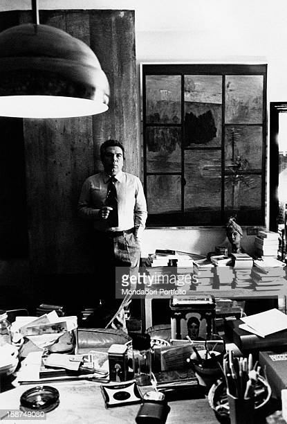 Italian director and scenarist Elio Petri posing in his study Rome 1978