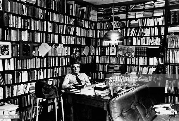 Italian director and scenarist Elio Petri sitting at the desk in his study Rome 1978