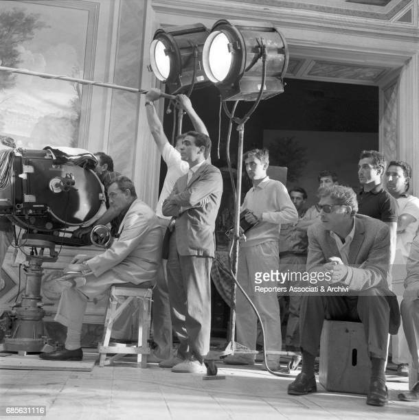 Italian director and scenarist Luchino Visconti sitting at the camera and directing the film 'The Leopard' Beside him Italian director of photography...