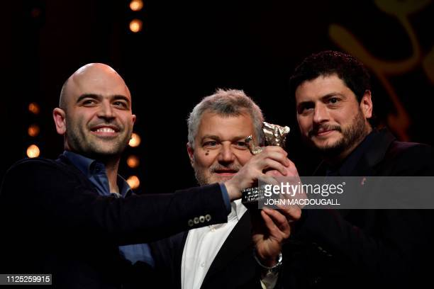 Italian director and screenwriter Claudio Giovannesi Italian author Roberto Saviano and Maurizio Braucci pose with their Silver Bear for best...