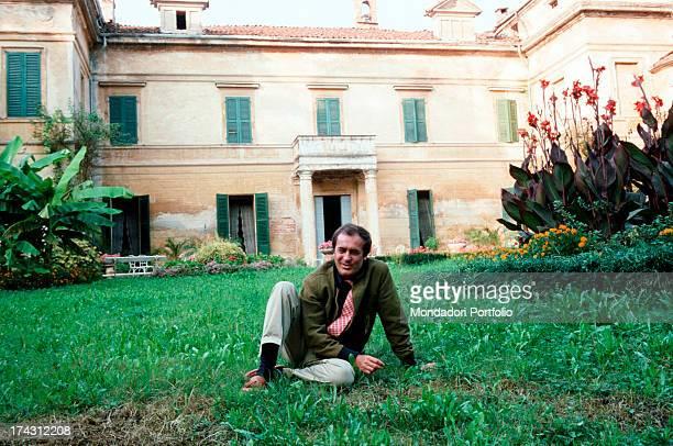 Italian director and scriptwriter Bernardo Bertolucci sitting in the garden af an ancient villa Parma 1981