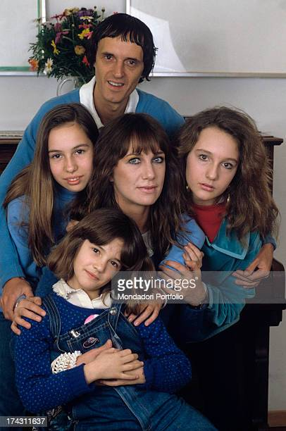 Italian director and scriptwriter Dario Argento and his wife the Italian actress Daria Nicolodi smiling and posing with their daughters and Italian...