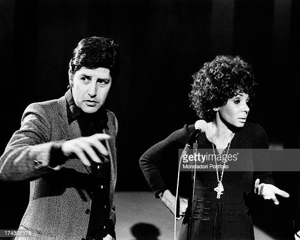 Italian director Antonello Falqui and British singer Shirley Bassey speaking into the microphone during the rehearsals of the TV broadcast Teatro 10....