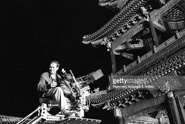 Italian director Bernardo Bertolucci directing a scene in The Last Emperor China 1987