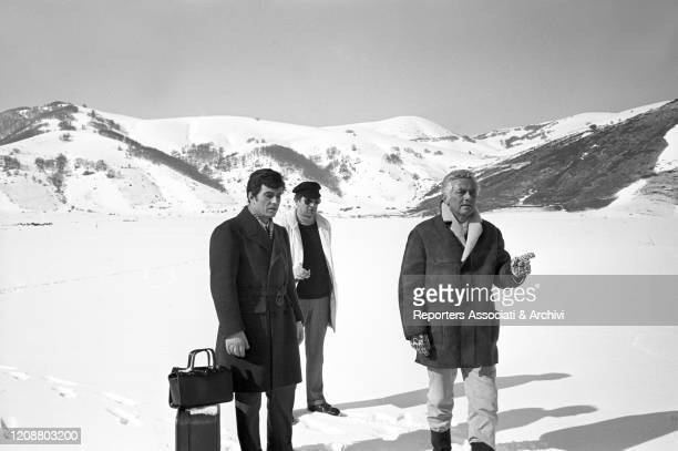 Italian director Dino Risi directing a scene on the snow beside Italian actor Nino Manfredi on the set of the film Kill Me with Kisses. 1968