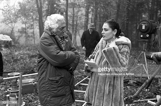 Italian director Dino Risi talking to French actress Clio Goldsmith on the set of the TV miniseries e la vita continua 1984