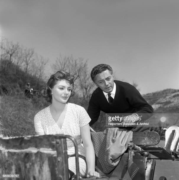 Italian director Dino Risi talking to Italian actress Sylva Koscina on the set of La nonna Sabella 1957