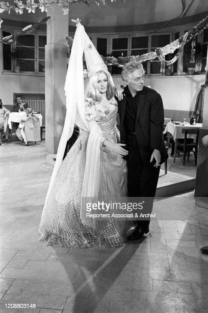 Italian director Dino Risi with American actress Pamela Tiffin dressed as a fairy on the set of the film Kill Me with Kisses. 1968