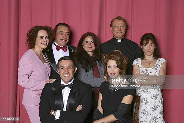 Italian director Elisabetta Marchetti crossing her arms surrounded by the actors of the cast standing from the left Caterina Sylos Labin Nino...