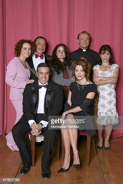 Italian director Elisabetta Marchetti standing folded arms surrounded by the actors of the cast standing up from the left Caterina Sylos Labin Nino...