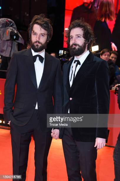 Italian director Fabio DInnocenzo and his brother italian director Damiano DInnocenzo arrive for the closing ceremony of the 70th Berlinale...