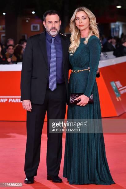 Italian director Fausto Brizzi and his companion Italian hammer throw athlete Silvia Salis arrive for the screening of US crime drama Motherless...