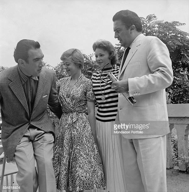 Italian director Federico Fellini and his wife Italian actress Giulietta Masina talking to MexicanAmerican actor Anthony Quinn during the XVIII...