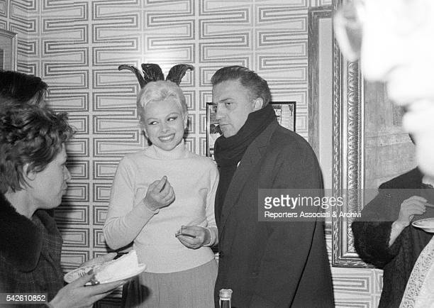 Italian director Federico Fellini and Italian actress Sandra Milo godfather and godmother at the reastaurant for the party of the Christening of...