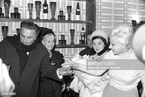 Italian director Federico Fellini and Italian actress Sandra Milo godfather  and godmother at the reastaurant for 6bcd763d368