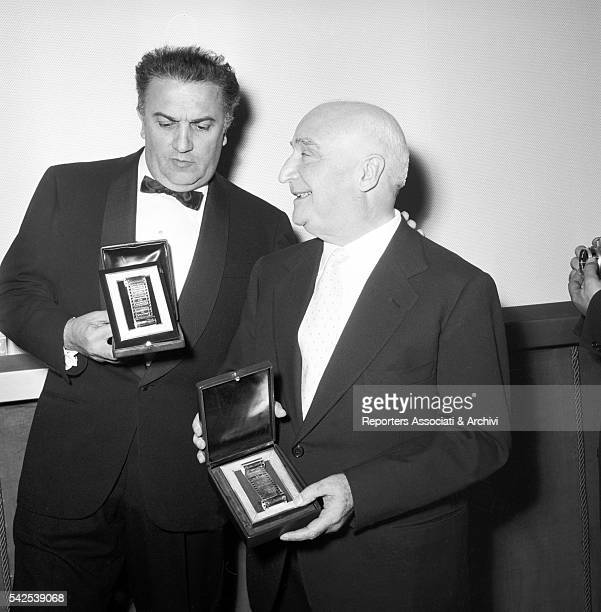 Italian director Federico Fellini and Italian publisher Angelo Rizzoli receiving a prize for 8 1/2 1964