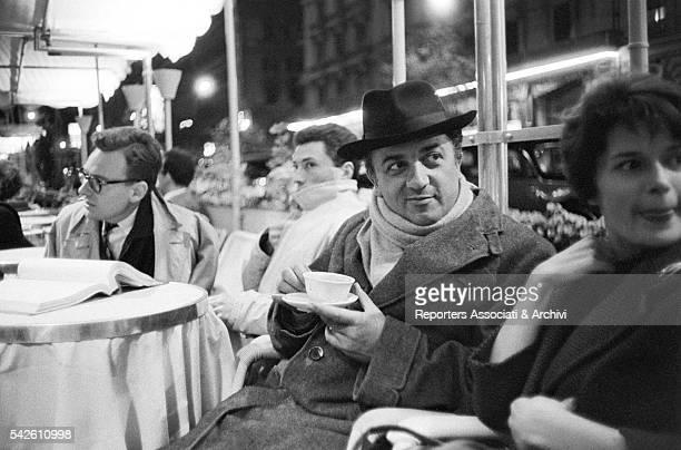 Italian director Federico Fellini drinking an espresso in a Via Veneto cafŽ with some friends Rome 1959