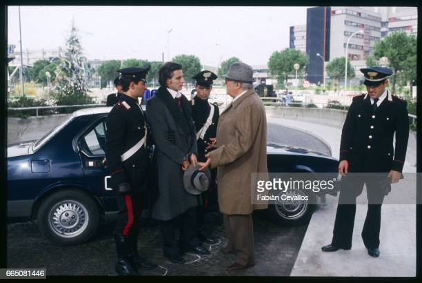 Italian director Federico Fellini gives his actors some advice before shooting a scene for his film Ginger e Fred or Ginger and Fred a satirical look...