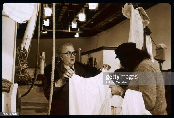 Italian director Federico Fellini is filming E La Nave Va The film was released as And the Ship Sails On in English and Et Vogue Le Navire in French...