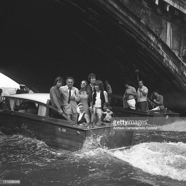 Italian director Federico Fellini portrayed with the troupe of the movie 'Satyricon' on a water taxi under Rialto bridge on the Canal Grande Venice...