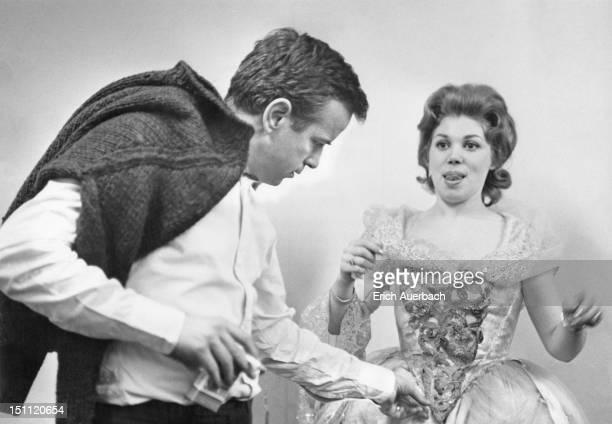 Italian director Franco Zeffirelli helps Italian soprano Mirella Freni with her costume for the Mozart opera 'Don Giovanni' at Covent Garden Opera...